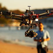 SYDNEY, AUSTRALIA - JULY 04:  Drone operator, Ken Butti lands the custom built DJI s1000 Drone at Palm Beach on July 4, 2014 in Sydney, Australia. Commercial and recreational UAV (Unmanned Aerial Vehicles) sales in Australia have regulators concerned about safety, privacy and security, while the commercial industries of mining, farming, property, and sport are embracing the new technology. Under the current CASA (Civil Aviation Safety Authority) regulations all unmanned aircraft weighing more than 2kg need to have a UAS operators certificate. Licensed operators are not allowed to fly above 400ft, not within 5km of an airfield boundary and can't fly within 30 metres of people not involved with the operation.  (Photo by Brendon Thorne/Getty Images)